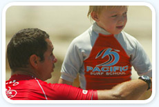 Kid and surfer instructor