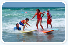 Kids learning to surf