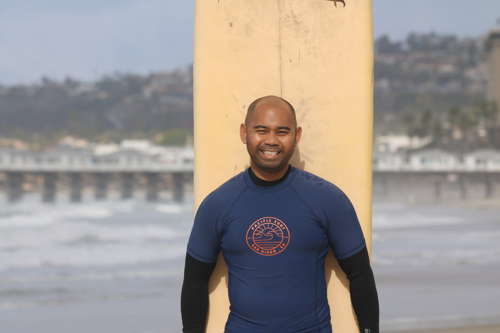 Man in the surfing lesson