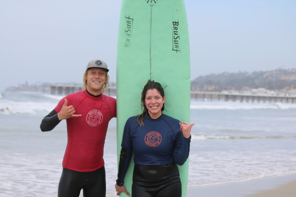 Man and woman in the surfing lesson