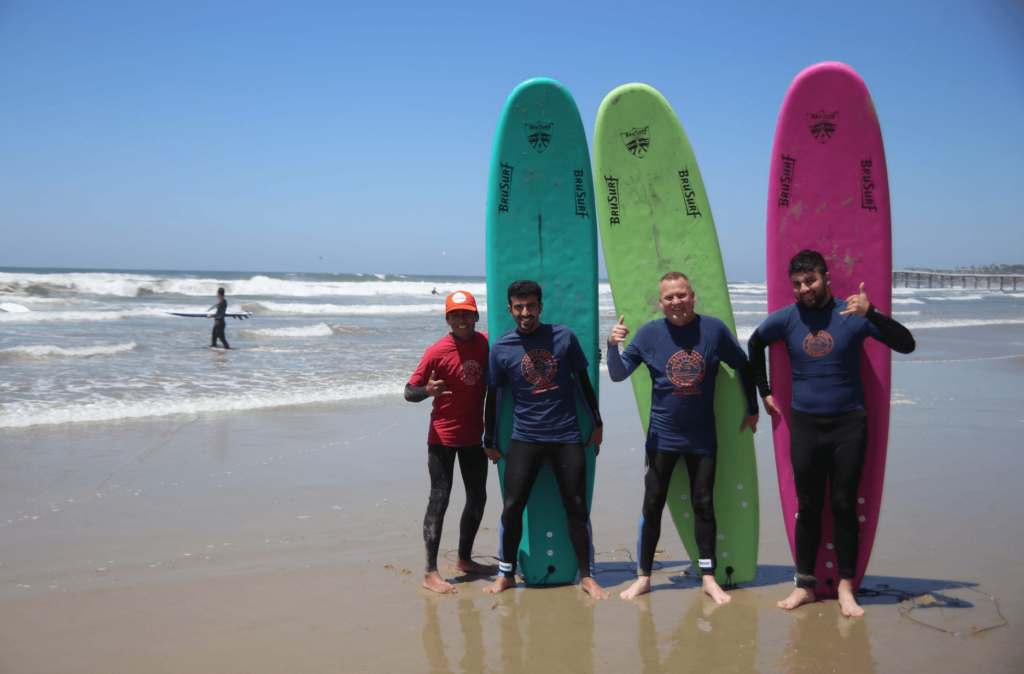 Surfer people with surfboards
