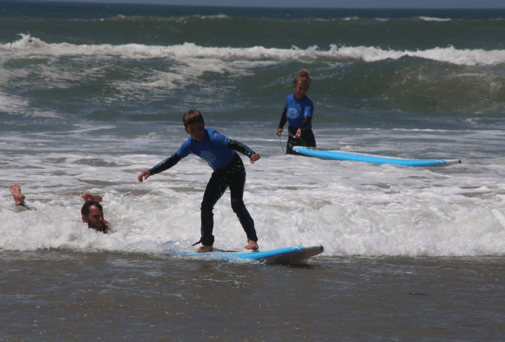 Boy learning to surf