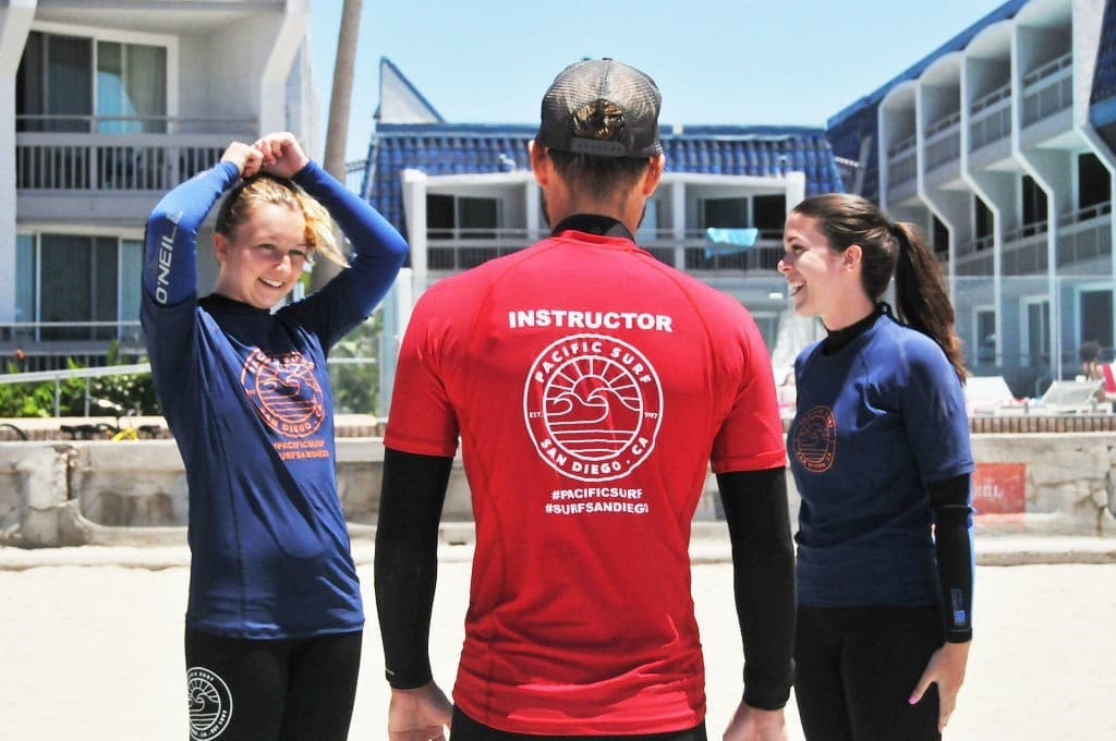 Women and surf instructor