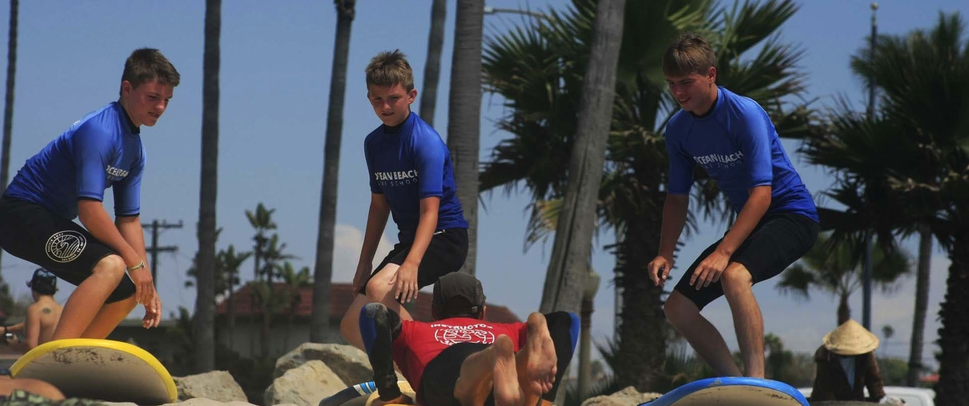 Children learning to surf in San Diego