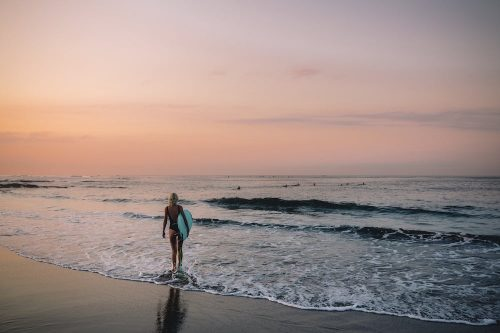 #2 Female surfer finds a less crowded wave to surf